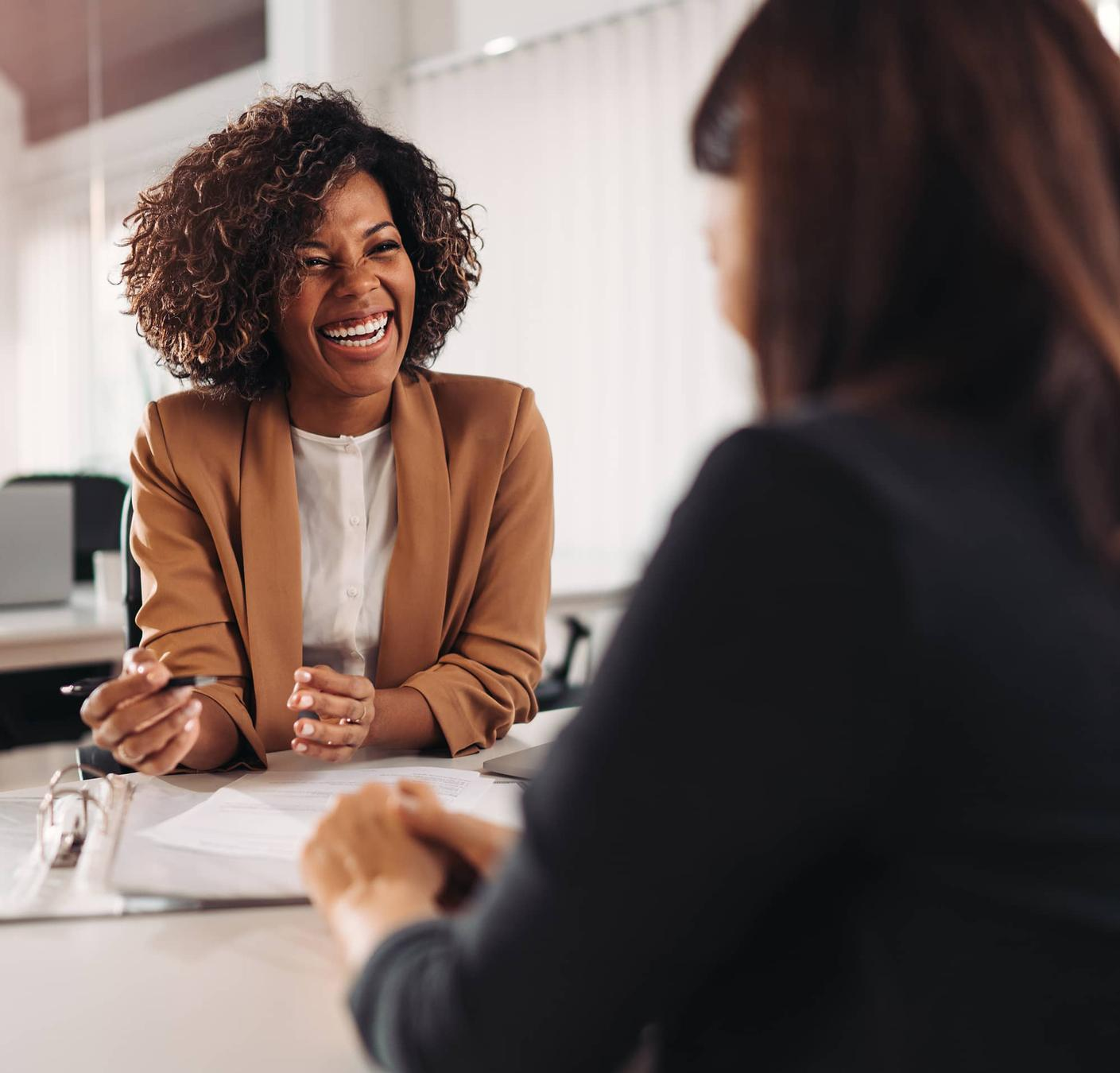 Woman with new hire smiling
